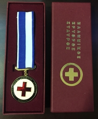 Medal of Red Cross in box, gold-plated, with enamel