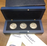 Wooden case with 3 Greek silver coins