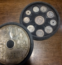 Collection of silver reproductions of various Greek coins