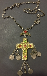 Silver cross with Turkish coins